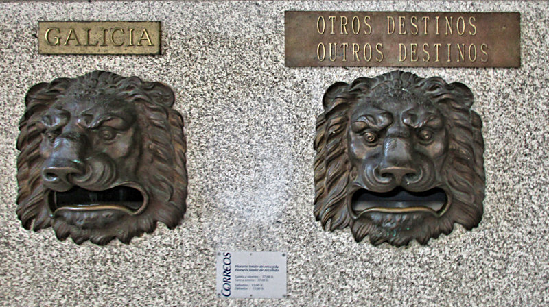 Lion--headed letter slots at the Lugo Post Office