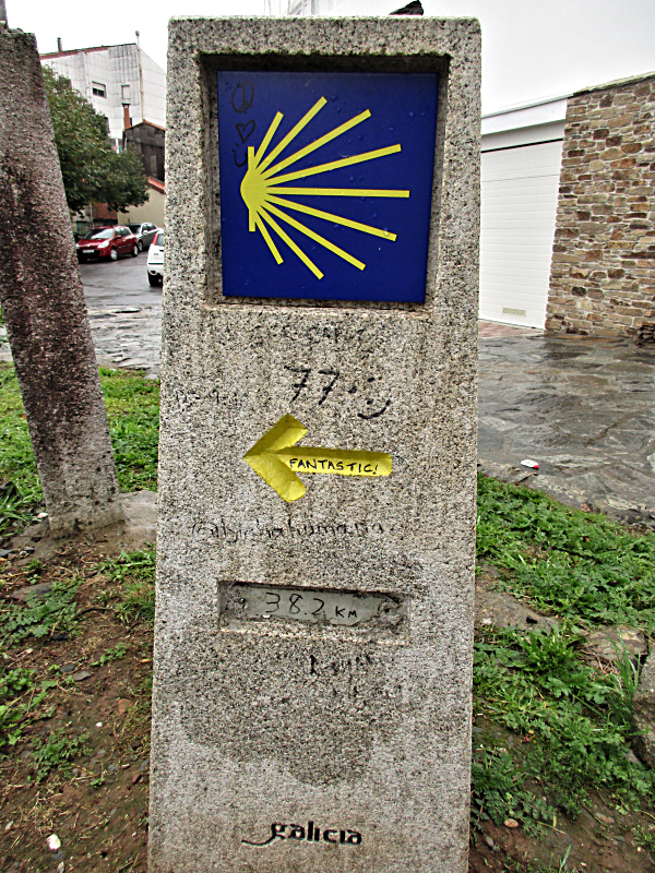 Defaced Camino distance marker