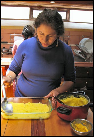 Mabel spreading potatoes
